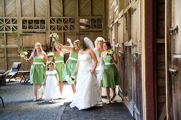 Bridesmaids bride and flower girl in green and white dresses for a barn wedding by destination wedding planner Mango Muse Events creator of Passport to Joy, the online wedding planning course for couples