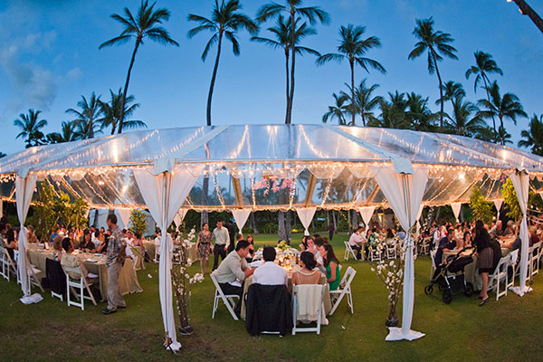 Clear tent with twinkle lights at a Hawaii wedding reception by destination wedding planner Mango Muse Events creator of Passport to Joy the online wedding planning course for couples