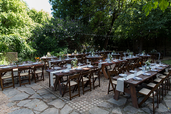Rustic wedding reception setup for a Russian River wedding in California by destination wedding planner Mango Muse Events creator of Passport to Joy the online wedding planning course for couples