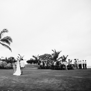 Wedding ceremony in Hawaii with a long wedding aisle and processional by destination wedding planner Mango Muse Events creator of Passport to Joy the online wedding planning course for couples