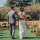 Bride and groom walking down the aisle at their wedding ceremony by destination wedding planner Mango Muse Events creator of Passport to Joy the online wedding planning program for couples