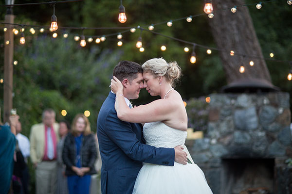 Couple enjoying their first dance on their wedding day at a rustic russian river wedding by destination wedding planner Mango Muse Events creator of Passport to Joy the online wedding planning course for couples