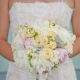 Bride in a lace wedding dress holding her peony pastel wedding bouquet for a summer wedding by destination wedding planner, Mango Muse Events creator of Passport to Joy the step by step online wedding planning program for couples