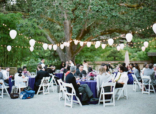 Purple and white outdoor wedding reception with string lights and paper lanterns at Hakone gardens by destination wedding planner Mango Muse Events creator of Passport to Joy the online weddig planning course for couples