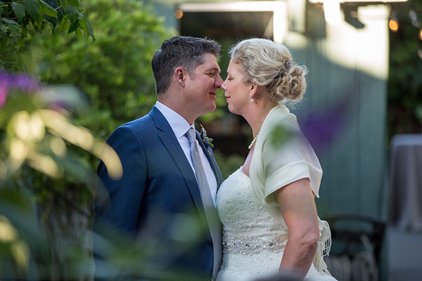 Bride and groom enjoying a moment at their backyard wedding by destination wedding planner Mango Muse Events creator of Passport to Joy the online wedding planning course for couples