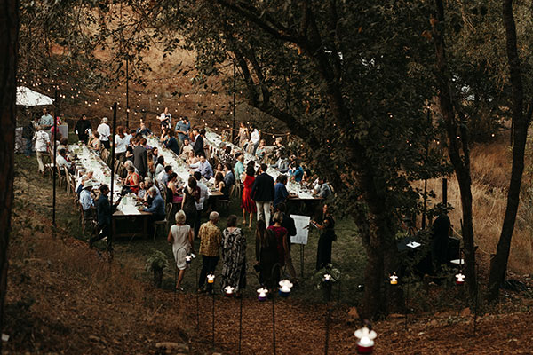 Boho rustic Yosemite wedding reception at Autocamp by destination wedding planner Mango Muse Events creator of Passport to Joy the online wedding planning program for couples