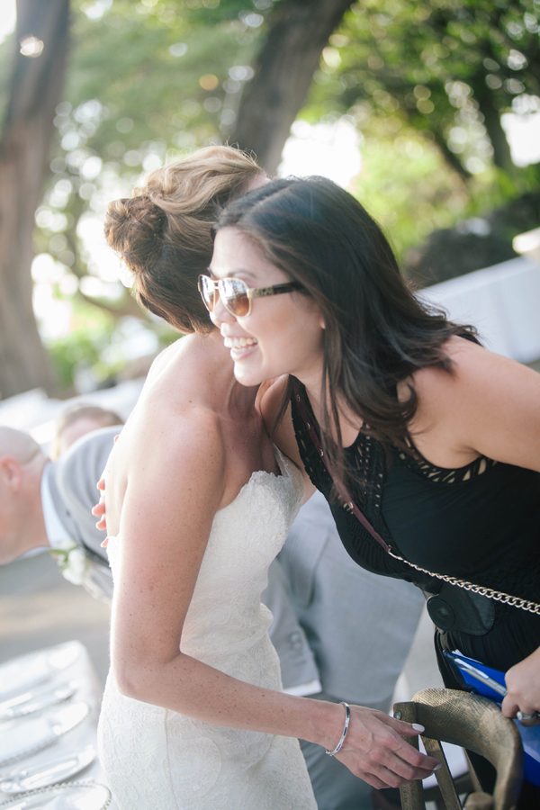 Destination wedding planner of Mango Muse Events and creator of Passport to Joy, online wedding planner and advisor, Jamie Chang hugs a happy bride at a Hawaii wedding
