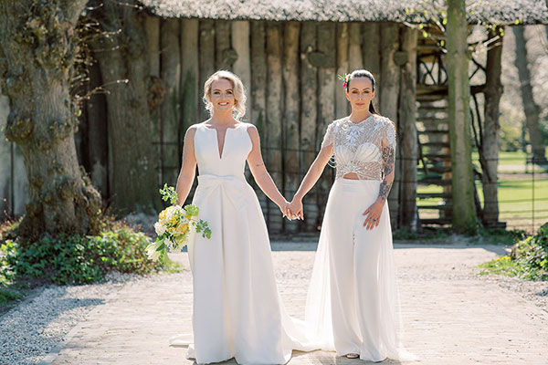Two happy brides at their lesbian wedding in Amsterdam Netherlands by destination wedding planner Mango Muse Events creator of Passport to Joy the online wedding planning course for couples
