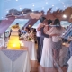 Bride and groom taking photos with wedding guests at a wedding reception with a yellow ombre wedding cake by destination wedding planner Mango Muse Events creator of Passport to Joy the online wedding planner and advisor