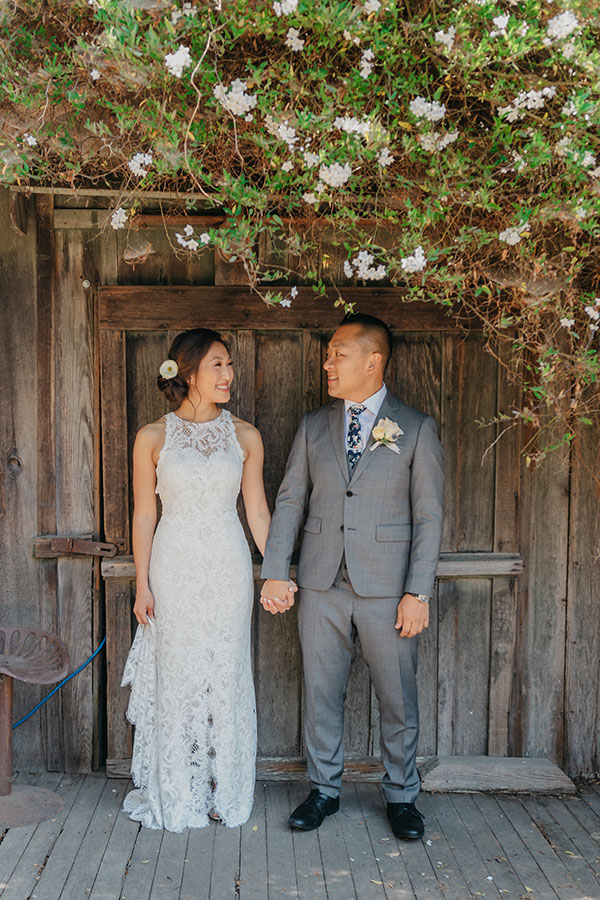 Happy bride and groom sharing a moment at their wine country wedding by Bay Area wedding planner Mango Muse Events creator of Passport to Joy online wedding planners and wedding planning course