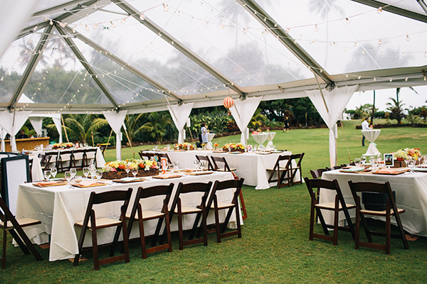 Clear tent for a tropical wedding reception at Loulu Palm private estate for a wedding in Hawaii by destination wedding planner Mango Muse Events creator of Passport to Joy online wedding planners and planning course