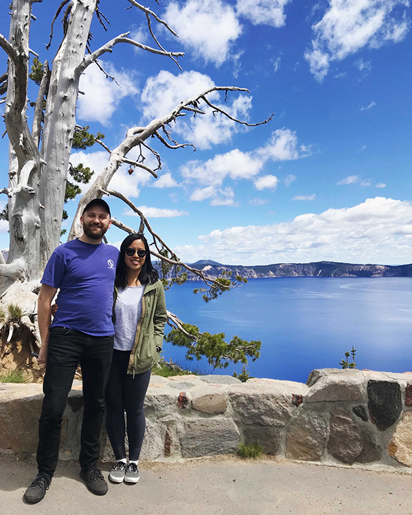 Couple taking at photo at Crater Lake celebrating an anniversary