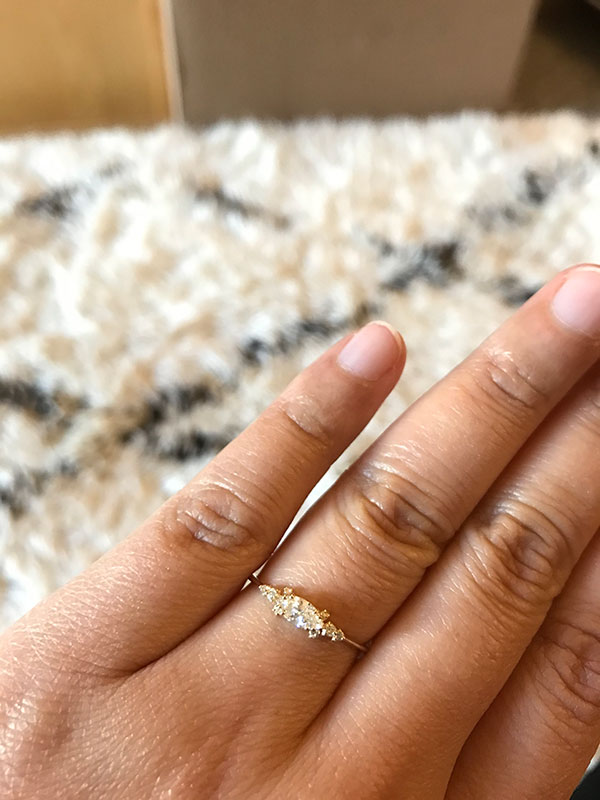 Engagement ring shopping online resulting in a delicate marquis gold ring with planning tips by Passport to Joy online wedding planners