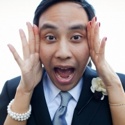 Groom and bride playing around making a freak out face on their wedding day by wedding planner Mango Muse Events creator of Passport to Joy online wedding planners and stress relievers
