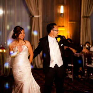 Bride and groom about to dance their first dance at their elegant wedding reception in San Francisco by destination wedding planner Mango Muse Events creator of Passport to Joy online wedding planners