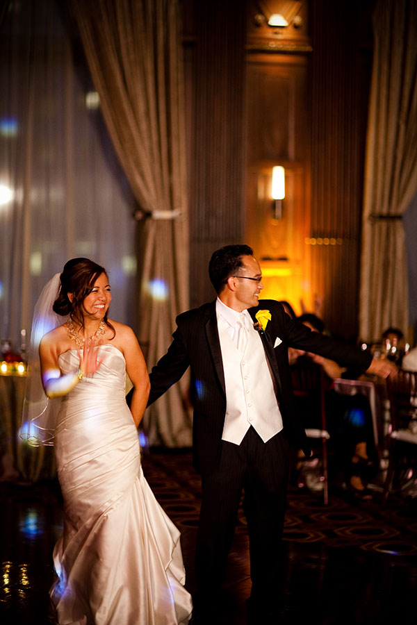 Bride and groom about to dance their first dance at their elegant wedding reception in San Francisco by wedding planner Mango Muse Events creator of Passport to Joy the online wedding planners