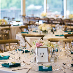 Classic and elegant wedding reception tables at a Carmel wedding at Quail Lodge by Destination wedding planner Mango Muse Events creator of Passport to Joy the online wedding planners and course for couples