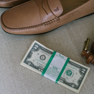 Groom shoes, belt and two dollar bills getting ready for wedding day by destination wedding planner Mango Muse Events creator of Passport to Joy online wedding planning course for couples