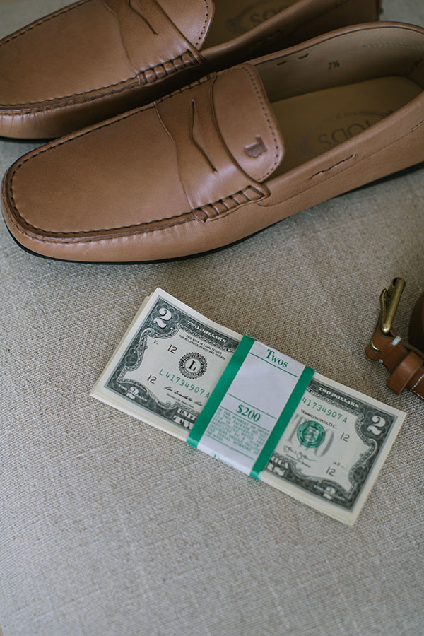Groom shoes, belt and two dollar bills for a destination wedding by destination wedding planner Mango Muse Events creator of Passport to Joy online wedding planning course for couples