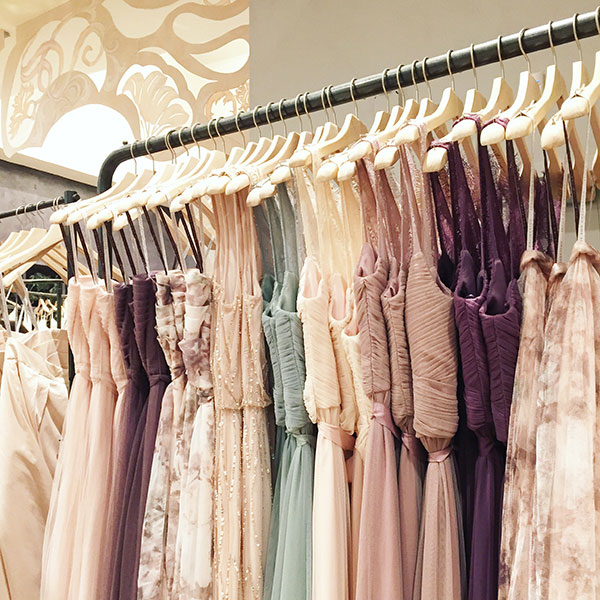 Colored wedding dresses and bridesmaid dresses at BHLDN while wedding dress shopping wedding planner turned bride Passport to Joy online wedding planners