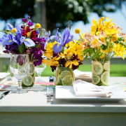 Purple and yellow flower wedding centerpieces at an outdoor private estate wedding in Hawaii by destination wedding planner Mango Muse Events creator of Passport to Joy online wedding planners