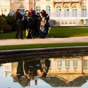 Wedding guests being directed to the ceremony by the wedding planner at a Paris destination wedding from Mango Muse Events creator of Passport to Joy, online wedding planners