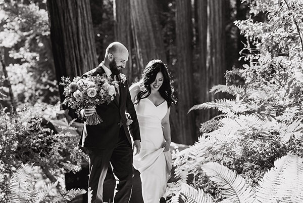 Happy bride and groom at their elopement wedding in Muir woods from Passport to Joy online wedding planners