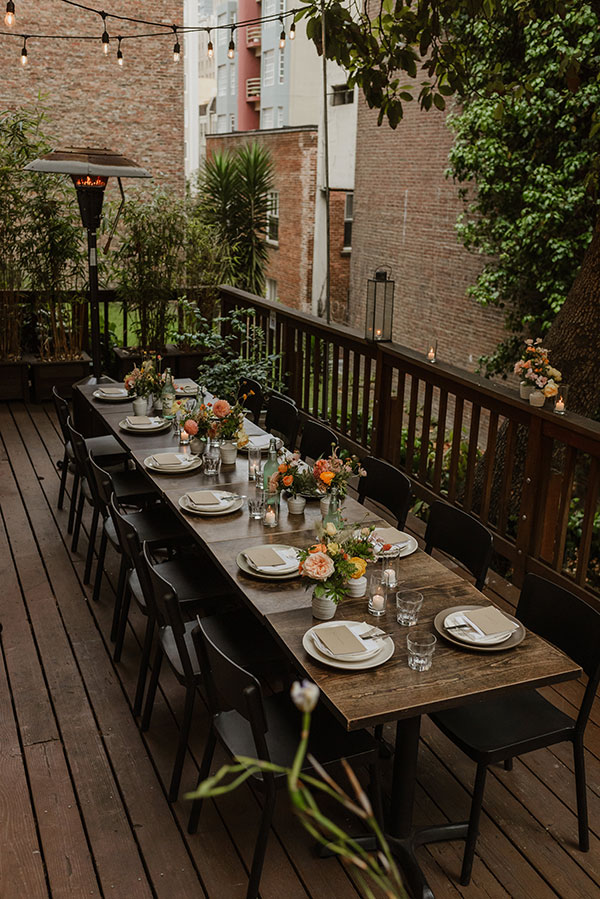 Long table with colorful centerpieces at a micro wedding at Del Popolo restaurant in San Francisco from online wedding planners Passport to Joy