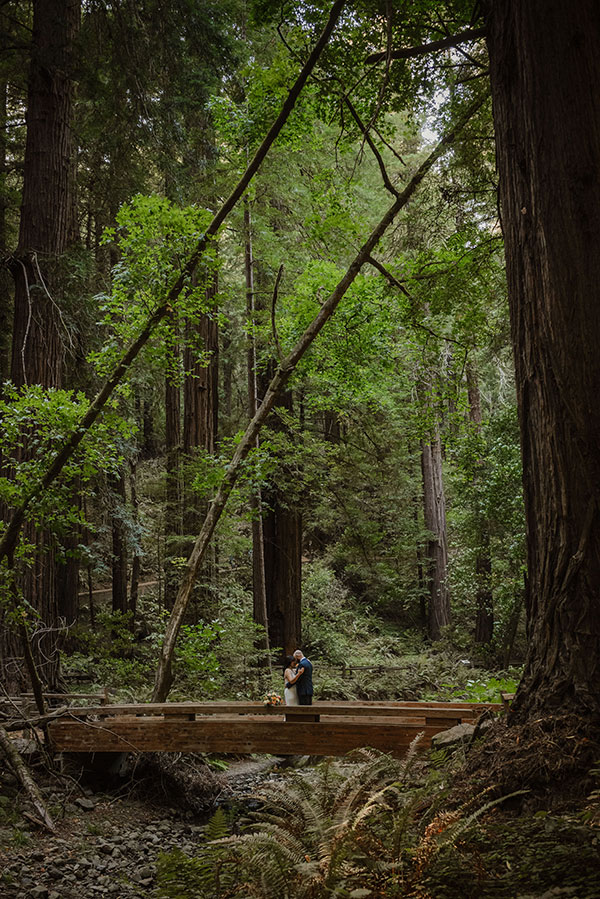 Couple amoungst the redwoods at their elopement wedding at Muir Woods from online wedding planners Passport to Joy