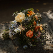 Peach, orange and blue wedding bouquet in sunset colors for a micro wedding in Muir Woods from online wedding planners Passport to Joy